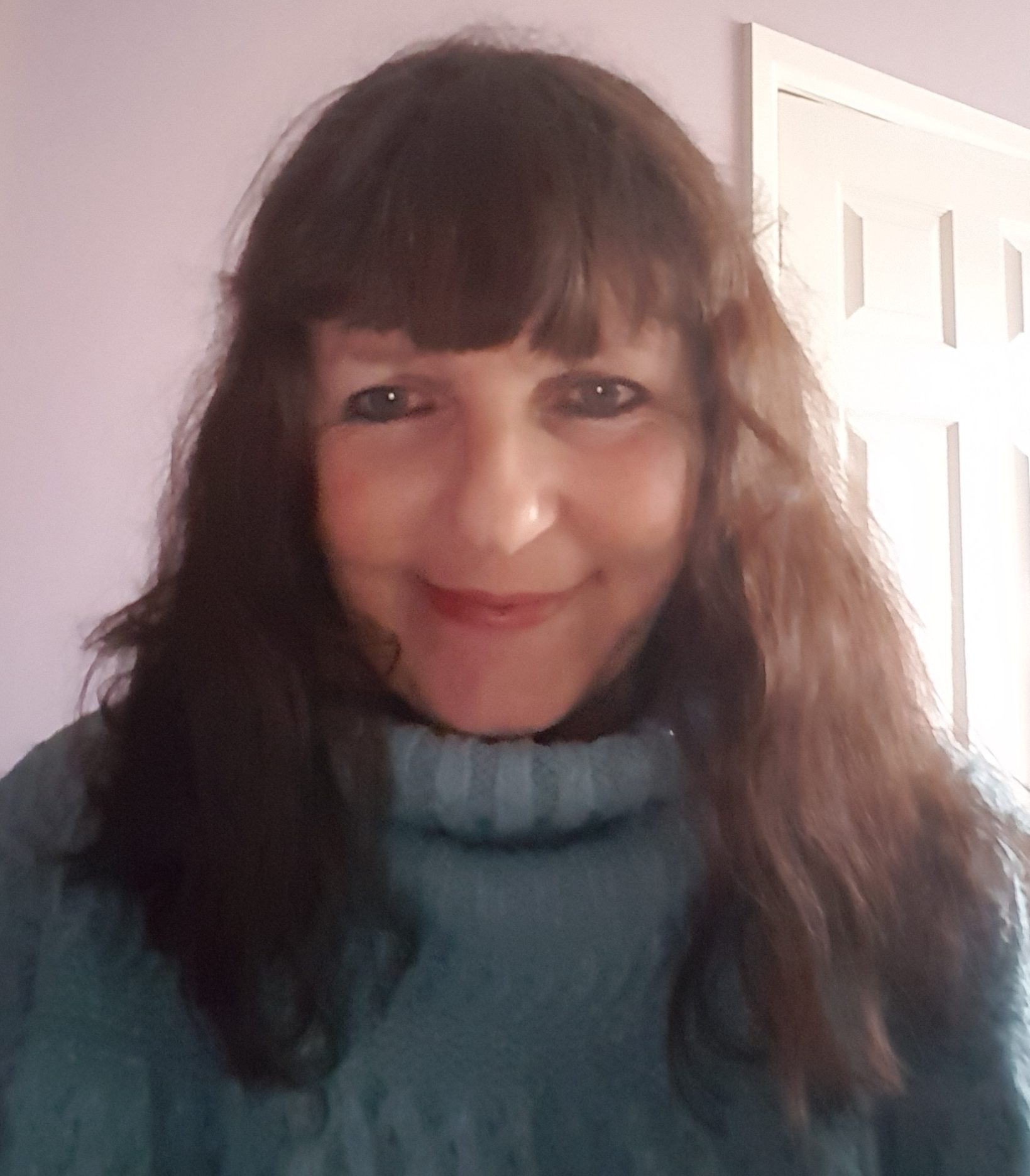 Vicky Tunaley wearing a light blue jumper and smiling.
