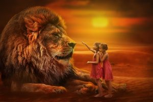 Large lion being approached by two little girls. Red sunset. Used on therapy website, Trance for a Change Hypnotherapy to show courage.
