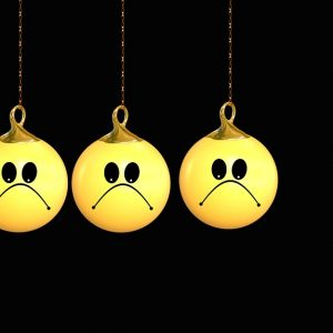 Lots of unhappy faced balls and one happy face ball
