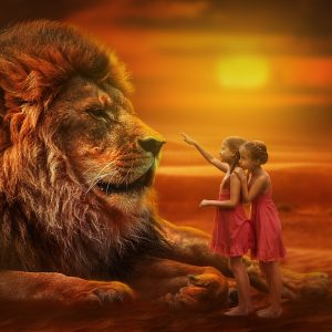 Large lion being approached by two little girls. Red sunset, used on therapy website, Trance for a Change Hypnotherapy